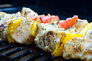 Barbecue Photos - Chicken And Pepper Kebabs Slowly Cooking On The Barbecue by Fizzy Image