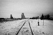 Sask Prints - CN canadian national railway tracks and grain silos Kamsack Saskatchewan Canada Print by Joe Fox