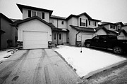 Driveways Prints - condos with snow cleared from streets and driveways Saskatoon Saskatchewan Canada Print by Joe Fox