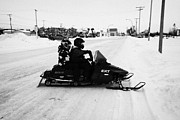 Sask Prints - couple on a snowmobile Kamsack Saskatchewan Canada Print by Joe Fox