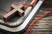 Christian Prayer Photos - Cross on Bible by Elena Elisseeva