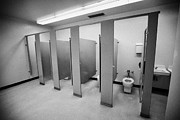 cubicle toilet stalls in womens bathroom in a High school canada north america Print by Joe Fox