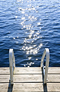 Wooden Dock Framed Prints - Dock on summer lake with sparkling water Framed Print by Elena Elisseeva