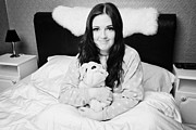 Early Photo Prints - Early Twenties Woman Holding Cuddly Dog Soft Toy In Bed In A Bedroom Print by Joe Fox