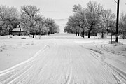 Snow Covered Street Framed Prints - empty intersection on snow covered street in small rural farming community village Forget Saskatchew Framed Print by Joe Fox