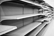 Problems Prints - empty shelves in a store in Saskatoon saskatchewan canada Print by Joe Fox