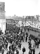 Baseball Stadiums Photo Framed Prints - Fans leaving Yankee Stadium. Framed Print by Underwood Archives