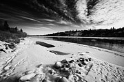 Sask Prints - frozen river bank of the south saskatchewan river in winter flowing through downtown Saskatoon Saska Print by Joe Fox