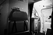 Galley Framed Prints - Galley And Emergency Exit On Passenger Flight In Europe Framed Print by Joe Fox