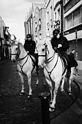 Police Officer Framed Prints - Garda Siochana Mounted Police On Horseback Taking Notes In Temple Bar Dublin Republic Of Ireland Framed Print by Joe Fox
