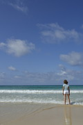Adolescence Photos - Girl contemplating ocean from beach by Sami Sarkis