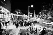 Escalator Prints - Going Down Escalator To Crowd Around Street Entertainer At Night Las Vegas Boulevard Nevada Usa Print by Joe Fox