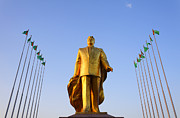 Flagpole Photos - Golden statue of Niyazov in the Park of Independence in Ashgabat Turkmenistan by Robert Preston