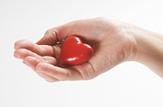Giving Photos - Heart in hand by Michal Bednarek