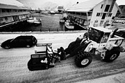 Heavy Weather Prints - heavy duty snow clearance machinery speeding through ice covered Honningsvag harbour finnmark norway Print by Joe Fox