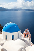 Greek Icon Photo Posters - Iconic blue domed churches in Oia Santorini Greece Poster by Matteo Colombo