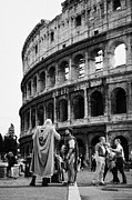 Centurion Posters - Imitation gladiators stand outside the Colosseum to get photographs taken with tourists Rome Lazio Italy Poster by Joe Fox