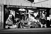 Murals Photo Prints - International wall murals in the republican falls road area of west belfast Northern Ireland Print by Joe Fox