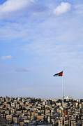 Jordanian Flag Flying Over The City Of Amman Jordan Print by Robert Preston