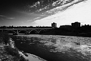 Sask Framed Prints - large chunks of floating ice on the south saskatchewan river in winter flowing through downtown Sask Framed Print by Joe Fox