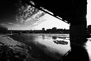 Sask Prints - Large Chunks Of Floating Ice On The South Saskatchewan River In Winter Flowing Under Traffic Bridge  Print by Joe Fox