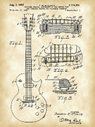 Parchment Framed Prints - Les Paul Guitar Patent Framed Print by Stephen Younts