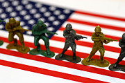 American Flag Acrylic Prints - Line of Toy Soldiers on American Flag Shallow Depth of Field Acrylic Print by Amy Cicconi