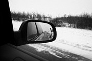 Wing Mirror Photos - looking at side view mirror winter driving along Saskatchewan highway 11 from Saskatoon to Regina Ca by Joe Fox