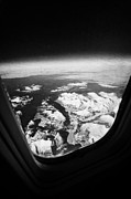 Snow-covered Landscape Photo Prints - Looking Out Of Aircraft Window Over Snow Covered Fjords And Coastline Of Norway Europe Print by Joe Fox