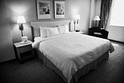 Large Sized Metal Prints - Luggage Lying On King Size Bed In A Us Hotel Room Miami Florida Usa Metal Print by Joe Fox