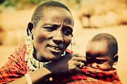 Sad Art - Maasai baby carried by his mother in Tanzania by Michal Bednarek