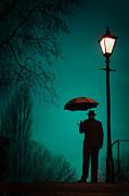 Man Holding An Umbrella Under A Victorian Street Light Print by Lee Avison