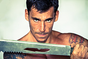 Shirtless Photos - Man holding sword blade by Fototrav Print