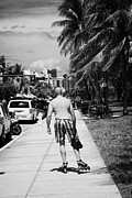 Blade Prints - Man Rollerblading Along Ocean Drive Early Morning Art Deco District Miami South Beach Florida Usa Print by Joe Fox