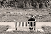 Casual Art Posters - Man Sitting On A Bench In A Countryside Scene Poster by Fizzy Image