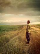 Sandra Cunningham - Man standing on Prairie looking out towards sky