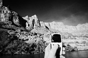 Video Art - man taking photos and video during boat ride along the colorado river in the grand canyon Arizona US by Joe Fox