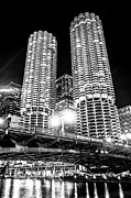 Glowing Water Posters - Marina City Towers at Night Black and White Picture Poster by Paul Velgos