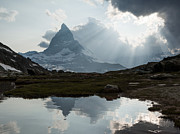 Zermatt Framed Prints - Matterhorn reflected in Riffelsee lake at sunset Framed Print by Matteo Colombo