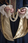 Gold Necklace Posters - Medieval Or Tudor Woman Holding A Pearl Necklace Poster by Lee Avison