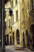 Streetlight Prints - Medieval street in France Print by Elena Elisseeva