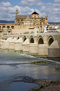 Medieval Temple Photo Posters - Mezquita and Roman Bridge in Cordoba Poster by Artur Bogacki