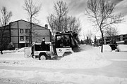 Winter Roads Prints - municipal city mini tractor clearing sidewalks and roads in Saskatoon Saskatchewan Canada Print by Joe Fox