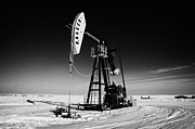 Sask Framed Prints - oil pumpjack in winter snow Forget Saskatchewan Canada Framed Print by Joe Fox