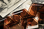 Filmstrip Posters - Old film strip and photos background Poster by Michal Bednarek