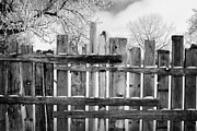 Rebuilt Prints - old patched up wooden fence using old bits of wood in snow Forget Saskatchewan Canada Print by Joe Fox