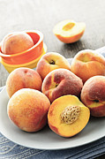 Sliced Photo Prints - Peaches on plate Print by Elena Elisseeva