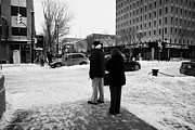 Crosswalk Framed Prints - people waiting to cross snow covered intersection crosswalk city street Saskatoon Saskatchewan Canad Framed Print by Joe Fox