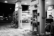 Sask Prints - petro canada winter gas fuel pump at service station Regina Saskatchewan Canada Print by Joe Fox
