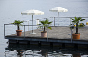 Sun Umbrella Posters - Pier with parasol Poster by Mats Silvan